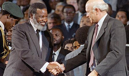 Dr Sam Nujoma shaking hands with South African president, FW de Klerk