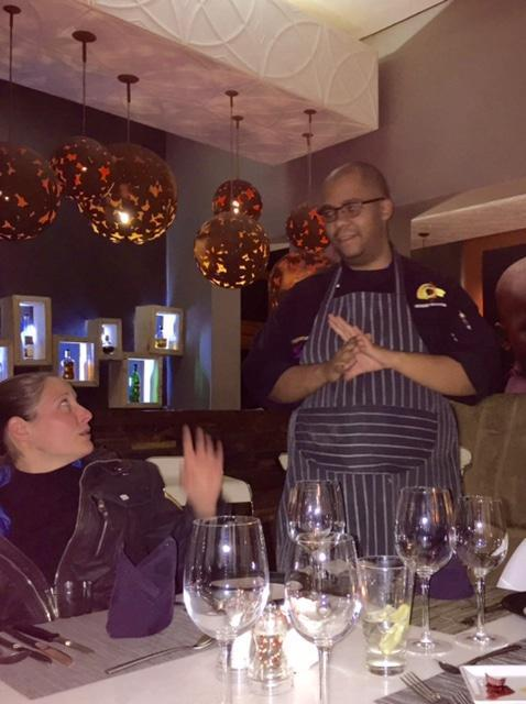 Chef Anthony explaining the evening's menu and getting Sandra all a-flutter